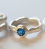 "Ring ""organic"" with a blue topaz"