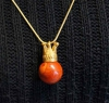 Pendant crown goldplatd with a coral ball.