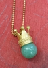 Crown pendant with a aventurin ball