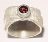 Broad silver ring with a tourmaline.